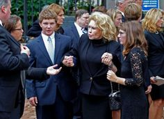 Grace and Max Kennedy hold hands with Joan Kennedy as the leave Holy Trinity Church in Washington Wednesday, Sept. 21,  2011, after funeral services for Kara Kennedy. Kara Kennedy died after a workout at a Washington health club. (Photo: Jose Luis Magana)