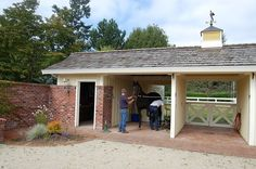Two exam & grooming bays in the separate tack/grooming/storage building across a small courtyard from the barn. Small Horse-Property Tour | Slideshows | TheHorse.com