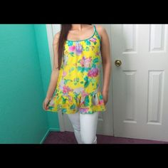 Floral tunic All floral everything! This tunic top has the cutest Ruffles at the bottom. It's sheer but looks great with a cami underneath! Feel free to make an offer via offer button only. •No Trades• Boutique Tops Tunics