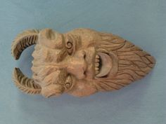 A hand-carved wooden demon's head.