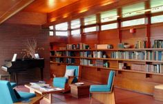 Clerestory windows, stained concrete floors, room for books...