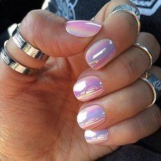 Reflective, white chrome nails.