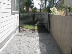Dog run with pea gravel and gate