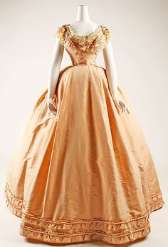 "Peach silk dress with evening bodice, French, ca. 1864. Labels: ""Mme. Cuper, Rue St. Honoré"" and ""Walker S. Poor, Ridgefield, Conn., 2/27/45"""
