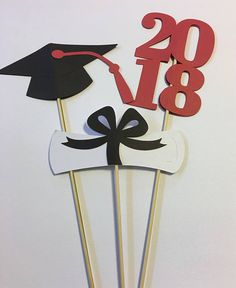 """Celebrate your high school or college graduate with their School colors! 6 piece Graduation Table Decor You will receive: 2 - Graduation Caps - 5 wide x 12"""" tall 2 - 2018 - 3"""" wise x 12"""" tall 2 - diplomas - 5 wide x 13"""" tall all are attached to a wooden skewers Select your school colors"""