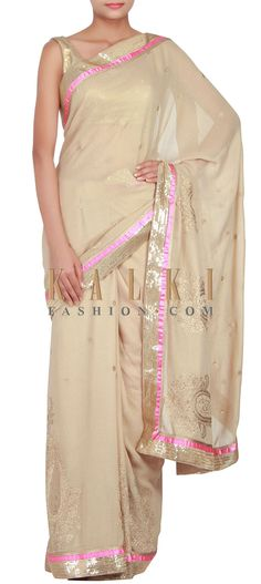 Buy Online from the link below. We ship worldwide (Free Shipping over US$100) http://www.kalkifashion.com/beige-saree-featuring-in-zari-and-kundan-embroidery-only-on-kalki.html
