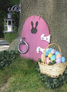 I love this idea. The door shows up a couple days before Easter so the bunny can check out the yard. Then Easter morning he leaves the basket and hides the eggs. Love the leprechaun door too.