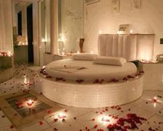 Rose Petals all around Bedroom  round bed  mirrors and candles set the mood  for    elaina   Pinterest   Rose petals  Round beds and BedroomsRose Petals all around Bedroom  round bed  mirrors and candles set  . Romantic Bedrooms With Roses And Candles. Home Design Ideas