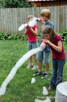 Making bubble snakes: Simple, easy and made with thing that I had laying around my house. Perfect! All you need is an empty water bottle from your recycling, duct tape, a sock that is missing its match (which we seem to have an abundance of), dish soap and some food coloring.
