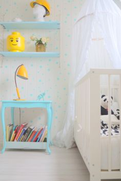 ciel and white country style nursery with lovely small dots on the walls
