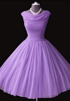 Lilac 1950's dress. Ready to wear fashion became popular. Poodle skirts were becoming popular also.