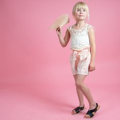 Paper bag pink shorts with a cream lace bodysuit and black crossed sandals. This outfit is cute! Lace Bodysuit, Pink Shorts, Creative Kids, Stylish Dresses, Cool T Shirts, Girl Outfits, Ballet Skirt, Cream, Sandals