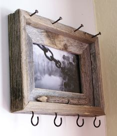 Rustic Key & Sunglasses Holder - I don't much care for the frame itself but I like the idea of using a frame and just adding the hooks at the bottom for keys.