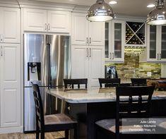 Montella off white cabinets in French Vanilla with a dark kitchen island in Buckboard
