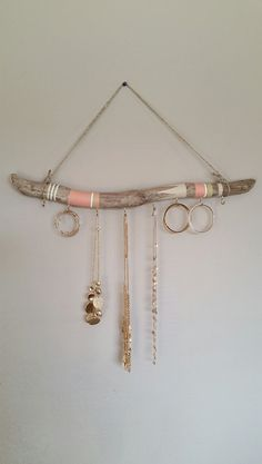 Driftwood Jewelry Organizer The driftwood is about 2ft long and 1-2 inches in diameter. There are eight 7/8 inch hooks on the driftwood to hang all your treasured jewelry on. If you would like different colors please send a, note to seller, the color scheme (in the form of a picture) that you would like on your jewelry organizer. It would be helpful to indicate which colors you would like to be the main colors and which colors you would like to be the accent. If there is no special color…