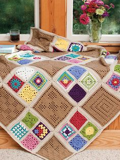 "This beautiful afghan is made using granny and filet square design patterns. A total of 61 squares made using a DK-weight yarn complete the design. Finished afghan size is 48"" square.                                                                                                                                                                                 More"