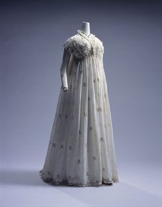 The high waistlines of the Empire and Regency eras meant that little to no adjustment was necessary for maternity fashion.  This lovely Italian round gown dates to circa 1795 and despite its generous waistline, would have been fashionable for women whether they were pregnant or not.