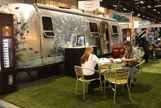 A 33-foot Airstream motor home served a dual purpose at the booth by sunglass-maker Costa: It provided meeting space for up to 15 people and also was a key piece of decor for the retro, beach-like atmosphere the company was trying to create