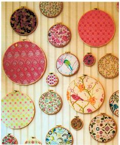 Way to display those special fabrics you love -- I like it with fabric covered squares instead of embroidery hoops.