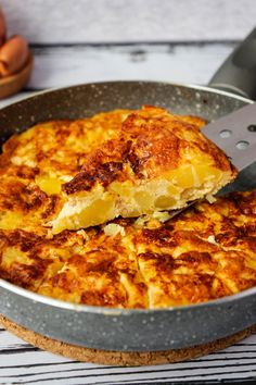 Very simple, fluffy potato and egg tortilla, served with olive oil and sprinkled with freshly ground black pepper. Quick and very easy to make.
