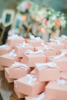 Pink favor boxes: http://www.stylemepretty.com/2016/07/15/how-to-plan-a-yes-way-rose-themed-wedding/