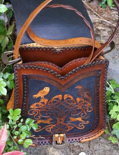 Multi-pocketed messenger bag with elaborate carving inspired by Y Mabinogi