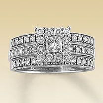 14K White Gold 7/8 Carat t.w. Diamond Bridal Set    A princess-cut center stone is framed by beautifully matched round diamonds in this elegant engagement ring. More round diamonds decorate the 14K white gold band. The matching wedding band features two additional rows of diamonds - one above and one below the engagement ring. 7/8 carat total diamond weight.