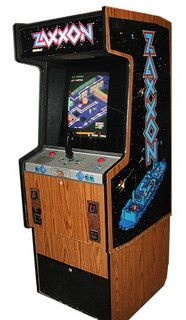 """1982: Zaxxon by Sega/Gremlin. You pilot an attack shuttle whose mission is to strafe the enemy's """"Asteroid City"""". Destroy fuel tanks, gun implacements, missiles, fighters and a large enemy robot. The game uses an isometric three-quarters perspective that was a unique concept to arcade games of that era. (Clic for gameplay footage.)"""