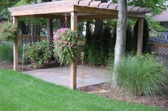A Brick Patio & Wood Pergola created by Hoehnen Landscaping Chagrin Falls, OH