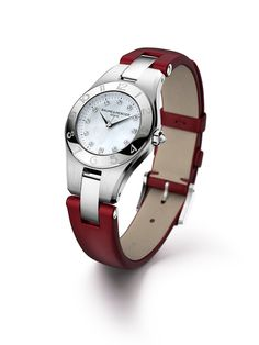 The Baume & Mercier Linea 10011 watch with diamond-set mother of pearl dial and interchangeable strap system, here on a Pepper Raspberry leather strap. Designed by Baume & Mercier, Swiss Watch Maker. Available at Hingham Jewelers.