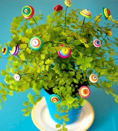Mother's Day Button Blooms--My mom made some fun button flowers a few years back.  I LOVE them!!  They are in her main bathroom.  This is a GREAT idea!!  *Trisha
