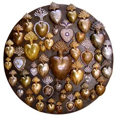 Collection of 19th century French Ex-Voto Hearts - nearly all of which open in back to reveal locks and have small loops so that they may be worn as necklace pendants -- France, 19th century.  (For sale on 1stDibs.com.)