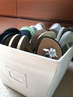 Organizing Shoes - flip flops and sandals in a labeled open canvas bin put under bench in garage #organizing