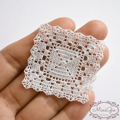 Miniature crochet white doily handmade with viscose embroidery thread and a tiny hook. This doily will give a romantic touch to you dollhouse, perfect for 1:12 scale, the stitches are so small that it can also be used in 1:24 scale. It measures 4.0 x 4.0 cm (1 5/8 inches square). Each doily is washed after finished and blocked with a lot of pins in a flat surface, it will lie flat on your miniature table allowing for cups or flower arrangements to sit and look true to scale. It also ca...