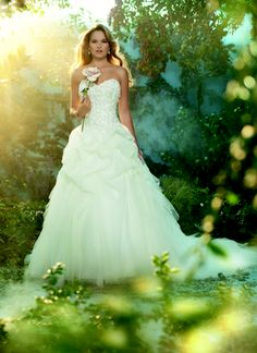Sleeping Beauty-Beautiful wedding dress and garden style wedding photos with flowers.
