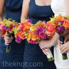 I love the navy dresses with colorful bouquets!