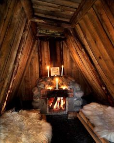 Cozy fireplace in a forest hut at Kolarbyn Ecolodge, Sweden