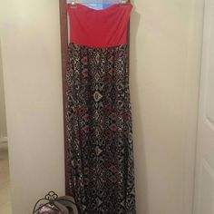Dress Beautiful red, white, black, and blue Aztec patterned maxi dress with sweetheart tube topped neckline. Size Large I believe, tag doesn't say. There is a small hole on the inside chest lining where padding was taken out, no visible damage. Dresses Maxi