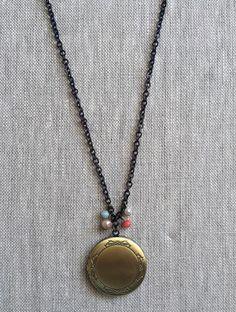 Dear Margot Bow Locket necklace @ http://www.realbabyinc.com