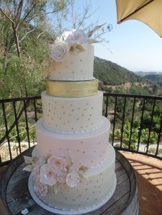 A Gorgeous Wedding Cake With Gold Accents