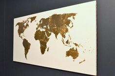 Make a decorative map using a canvas and imitation gold leaf. | 23 DIY Ways To Fake It Until You Make It