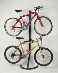 Freestanding bike storage rack that supports itself and up to 2 bikes     Independent adjustment arms for level bike storage.     Vinyl-coated bike cradles and base protect bikes and the floor.     Epoxy-coated black finish.     Dimensions:   200cm x 64cm x 48cm