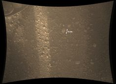 Mars Rover Curiosity: Martian Color - This color view from NASA's Mars rover Curiosity shows the Martian surface covered in small rocks. NASA unveiled this image on Aug. 8, 2012.