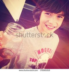 Young boy holding up bottle - Instagram effect Young Boys, Photo Editing, Royalty Free Stock Photos, T Shirts For Women, Bottle, Pictures, Photography, Image, Collection