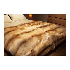Repurposed old fur coat made into a throw blanket.