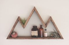 Check out this cool shelf for your space! Get this Mountaineer Wood Shelf for only $29.99! Normally $48.00! Made from 100% American Grown Hemlock, these rustic wall ornaments add charm to any room. Available in a walnut or weathered gray finish.