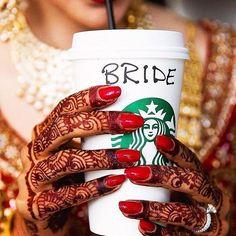 Red nails and mehendi hands are a perfect bridal combo!    Photo courtesy - @elkin.cardona    #coffee #nails #coffeelove #manicure #bridetobe #bride #bridalbling #bridalinspration #bridalinspo #swag #coollook #weddingphotography #bridalphotography #bridegoals #photography #look #coffeetime #coffeecup #coffeeshop #coffeeholic #coffeegram #coffeelife #coffeeporn #coffeeaddict #mehendi #bridalmehendi