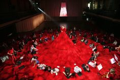 Sitting on a Giant Red Dress - My Modern Metropolis
