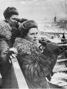 World War II, in Russia – the Great Patriotic War (22 June 1941 – 9 May 1945). Female observers of an air defence unit on the roofs of besieged Leningrad. 1944.