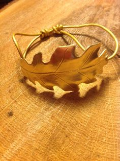 I love anything leafy! Brass Oak leaf molding to the shape of your wrist, make a statement with any outfit you are wearing.  Adjustable leather slide knotting in gold leather.